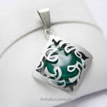 Silver jewelry. A beautiful pendant with Malachite
