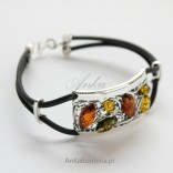 Silver bracelet with colorful Amber on the rubber