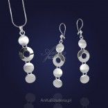 Silver set. Long earrings and pendant in circles.