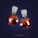 Silver earrings with white and red zircons.