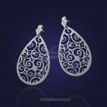 "Silver laser earrings - ""dancing snowballs""."