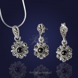 A jewelry set. Earrings and pendant with onyx and marcasites.