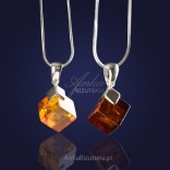 Amber cube on a chain of silver in a cognac or cherry color.