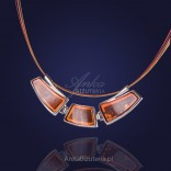 An elegant amber necklace in a beautiful frame made of silver.