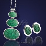 An extravagant emerald set in a silver frame.