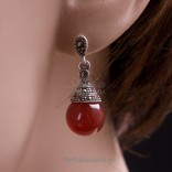 Kameol and a sophisticated flash of brandites - fashionable earrings.