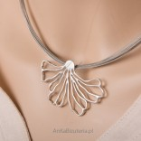 Silver necklace on steel links. Artistic jewelry.