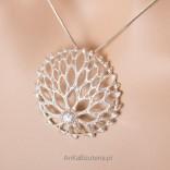 Openwork sun. Silver pendant with beautiful zircon