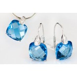 Set: earrings with silver pendant with blue topaz.