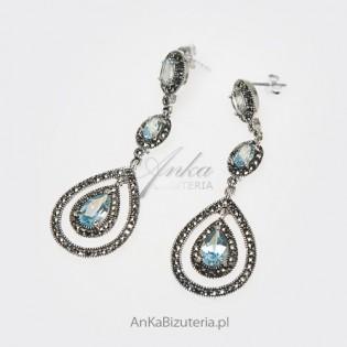 Wyborne kolczyki srebrne z markazytami i jasnobłękitnymi kryształami.