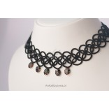 Hand made jewelery necklace with black threads.